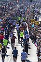 Germany, North Rhine-Westphalia, Cologne, marathon runner and spectators at Cologne Marathon - EG000005