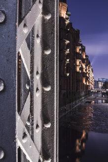 Germany, Hamburg, Illuminated Pillar of a girder bridge in the historic warehouse district - NKF000053