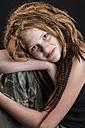 Portrait of teenage girl with red hair dreadlocks - EG000013