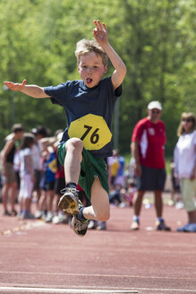Germany, Munich, Boy longjumping on sports meeting - EGF000091
