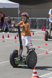Germany, Bavaria, Boy riding segway - EG000097