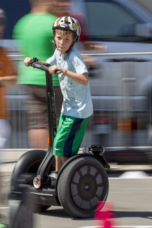 Germany, Bavaria, Boy riding segway - EG000098