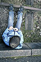 Child sitting next to overgrown rails of Vaihingen, Baden-Wuerttemberg, Germany - SBDF000549
