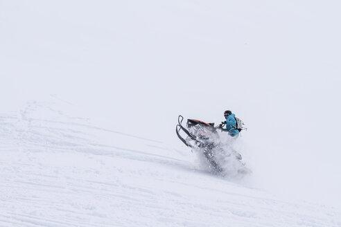 Canada, Whistler, Man snowmobiling - AMCF000047