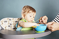 Baby in highchair being fed - IPF000010