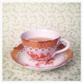 Tea Cup on Cute Green Floral Background, Orange, Golden Rim - MVC000114