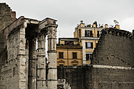 Italy, Rome, Ancient columns in front of residential buildings - KAF000098