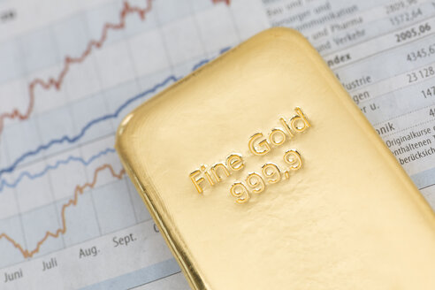 Gold bar and financial newspaper - DR000511