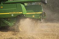 Germany, Rhineland-Palatinate, Rhineland-Palatinate, Combine harvester on barley field - PA000400
