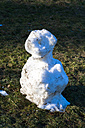 Germany, leftovers of snowman on a meadow - TCF003910