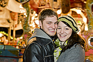 Germany, Berlin, portrait of smiling young couple head to head at Christmas market - CLPF000063