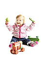 Toddler playing with wooden toy in front of white background - IPF000015