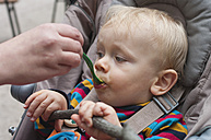 Portrait of toddler eating pap - MU001428