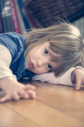 Portrait of little girl lying on the floor - LVF000686