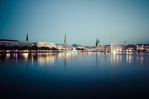 Germany, Hamburg, Binnenalster with skyline at blue hour - KRP000284