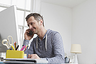 Man at desk on the phone - RBYF000473