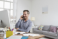 Man at desk on the phone - RBYF000363