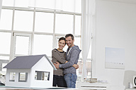 Couple at home with model house - RBYF000375