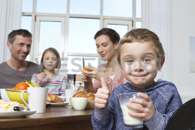 Family of four having healthy breakfast - RBYF000447