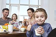 Family of four having healthy breakfast - RBYF000447