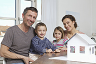 Family of four with house model - RBYF000455