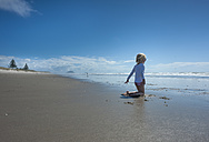 New Zealand, North Island, Bay of Plenty, Tauranga, Papamoa Beach, girl playing at the beach - JB000047