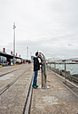 New Zealand, North Island, Auckland, boy looking into pipe - JB000049