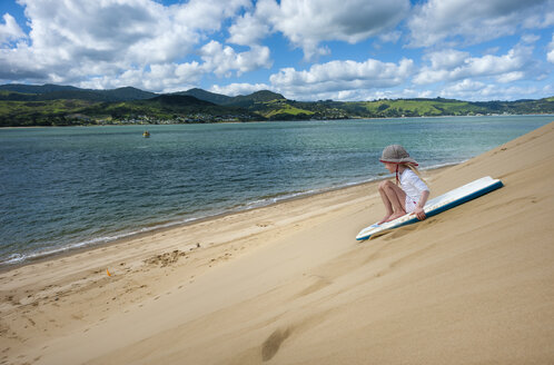 New Zealand, North Island, Northland, Hokianga Harbour, girl on sandboard - JB000055
