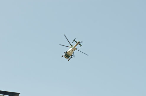 Germany, Police helicopter, mid air - JED000146