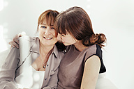 Portrait of mother and daughter laughing together - MFF000903