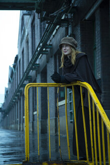 Germany, Berlin, woman leaning on yellow railing - NG000099