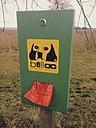 Dog poop bags in holder at Lake Chiemsee, Bavaria, Germany - MEA000198