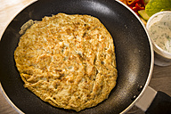 Fried omelette in a pan, Ingredients for Kebab Omelett, Low Carb - CSTF000054