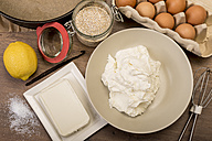 Baking ingredients of cheese cake on wooden table - CSTF000057
