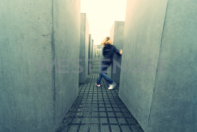 Germany, Berlin, view to Holocaust Memorial with running girl - PA000429