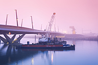 Germany, Hamburg, Hafencity, Baaken-harbour, bridge, ship with crane, early morning fog - MS003397