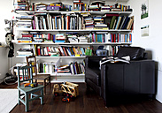 Book shelf and toys in a room with armchair and chairs - TKF000294