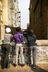 South Africa, Johannesburg, Three young boys on a little bridge - TK000284