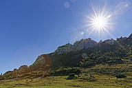 Germany, Upper Bavaria, Bavaria, Chiemgau Alps, Kampenwand against the sun - SIEF005099