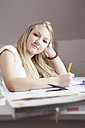 Portrait of teenage girl at her desk - VTF000102