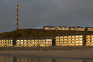 Germany, Helgoland, Morning light reflecting in windows - FOF006389