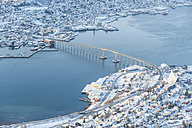 Norway, Troms, Tromso, View from Storsteinen, Cityscape, Tromso Bridge in winter - PAF000449