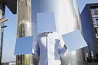 Man hidden behind light blue rectangles - FMK000962