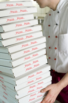 Man carrying stack of pizza boxes - LB000582