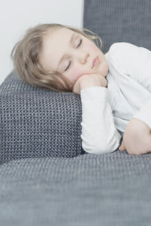 Portrait of little girl sleeping on a couch - MW000036
