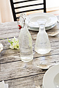 Water bottle and carafe on festive laid table - LVF000751
