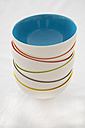 Stack of six coloured bowls on white background - LVF000769