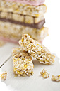 Two pieces of granola bars on wooden table - MAEF008054