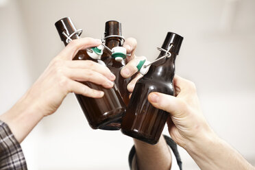 Friends clinking beer bottles - FMKF001019