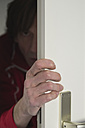 Man looking man opening door - MUF001458